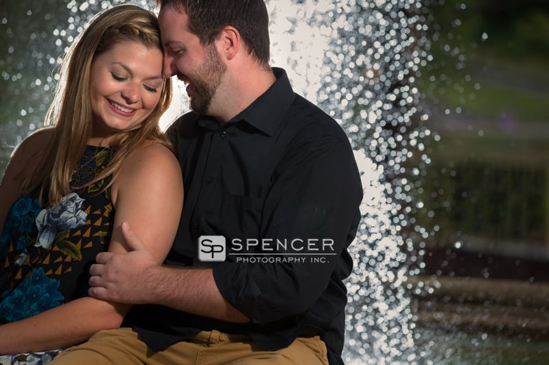 engagement picture at fountain in wade oval park