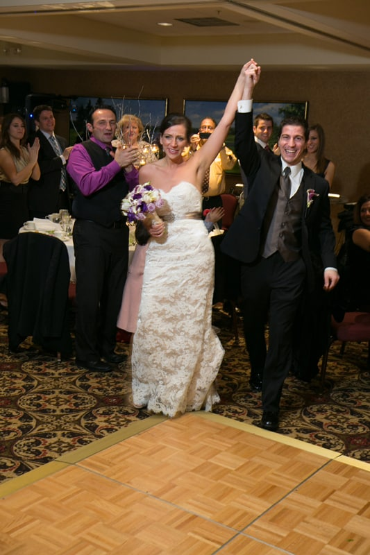 bride and groom enter their wedding reception at firestone