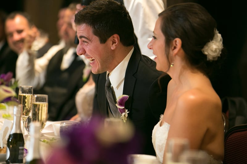 groom laughing at wedding reception at firestone