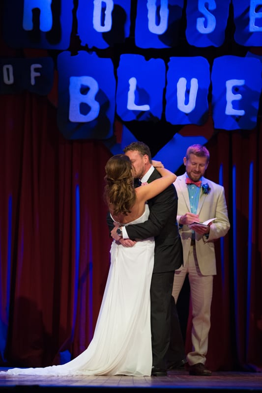 first kiss after their wedding ceremony at house of blues
