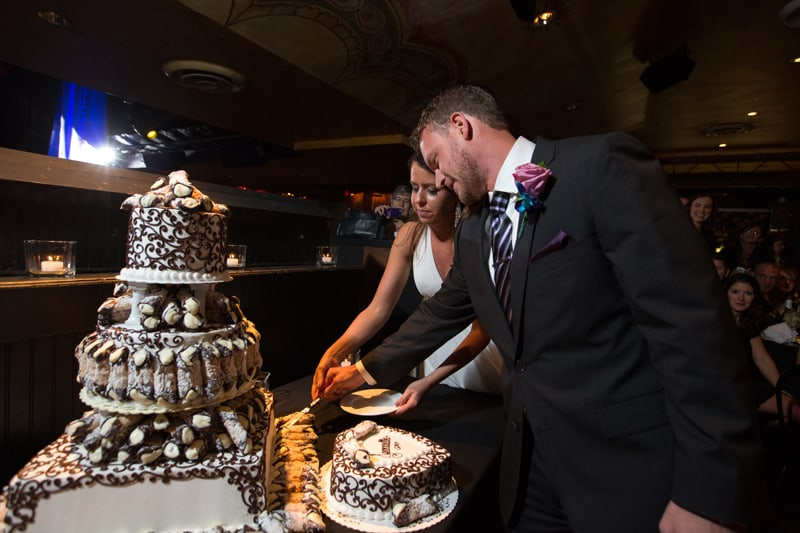 bride and groom cutting their wedding cake at house of blues