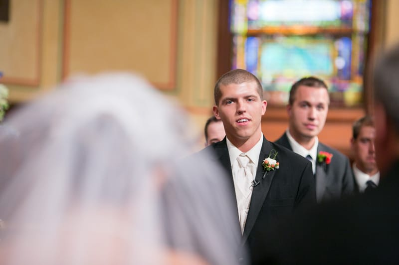 groom seeing bride walk down aisle at old stone church cleveland