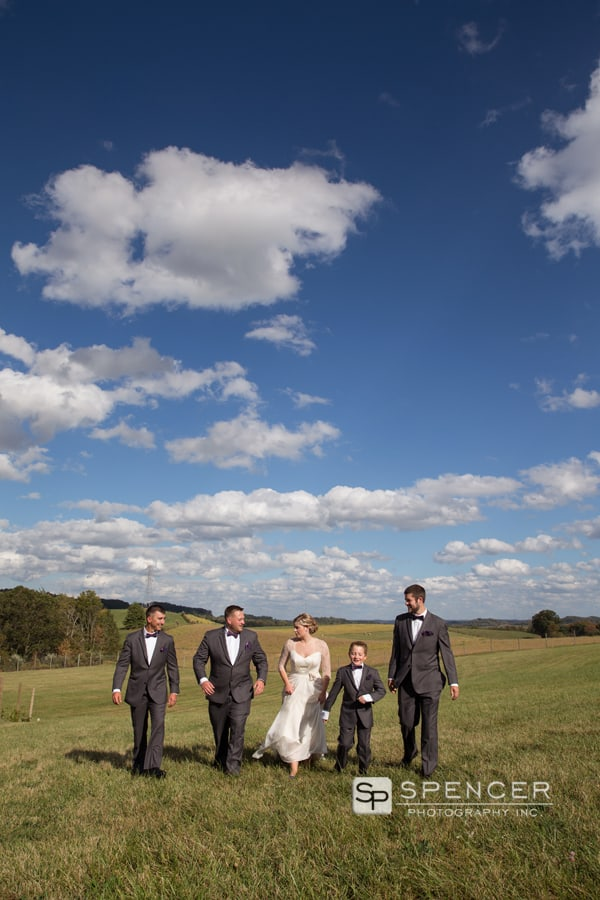groomsmen walking with bride at breitenbach
