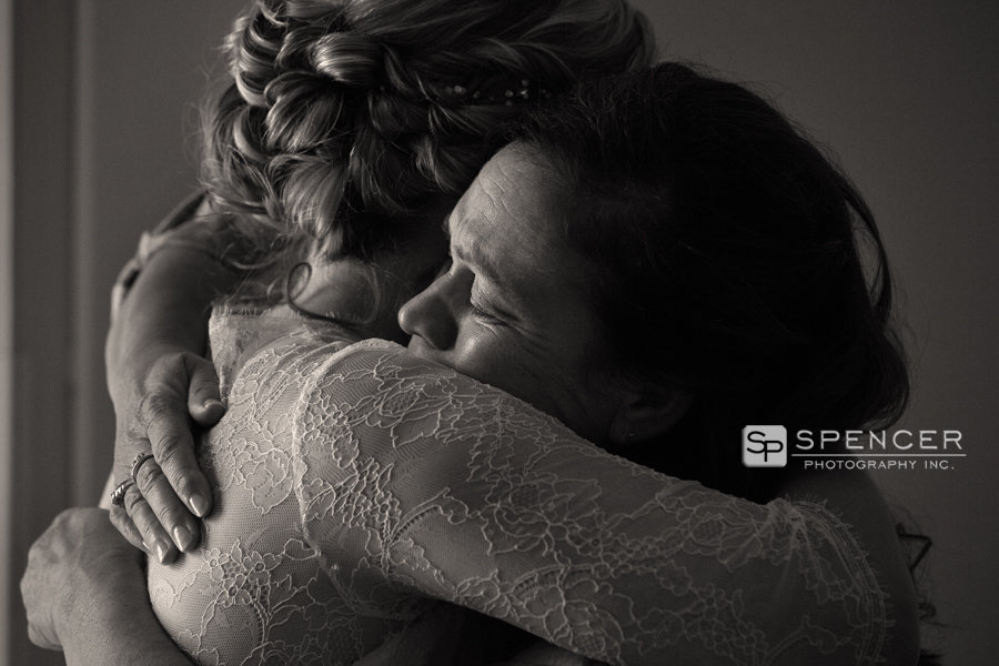 mom crying hugging bride