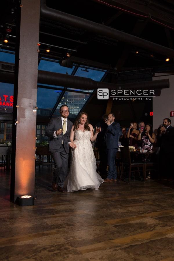 bride and groom enter their wedding reception atmusic box supper club