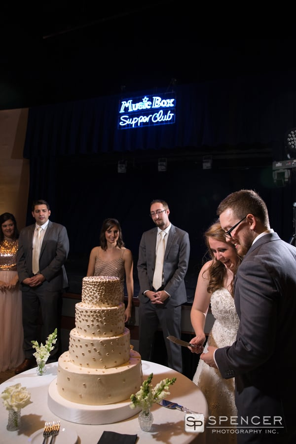 cutting the wedding cake at wedding reception at music box supper club