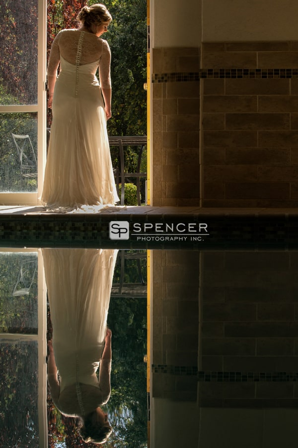 picture of bride by swimming pool