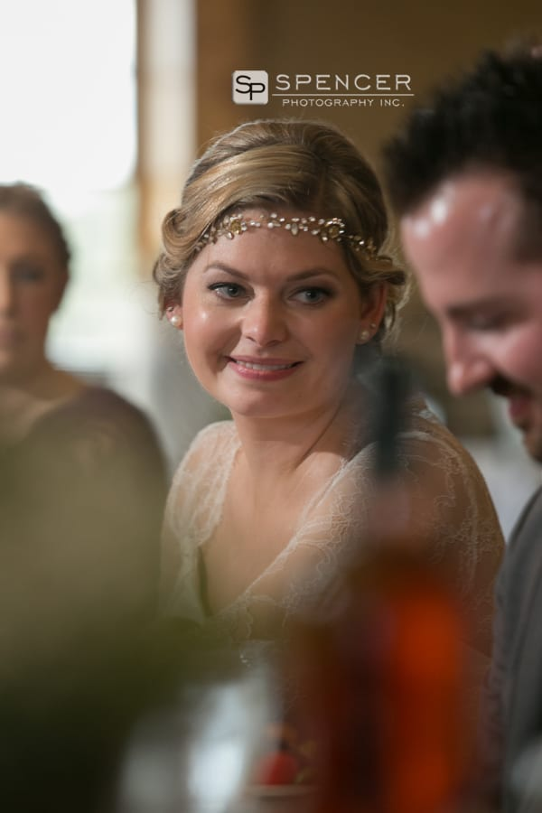 bride smiles at groom during breitenbach reception