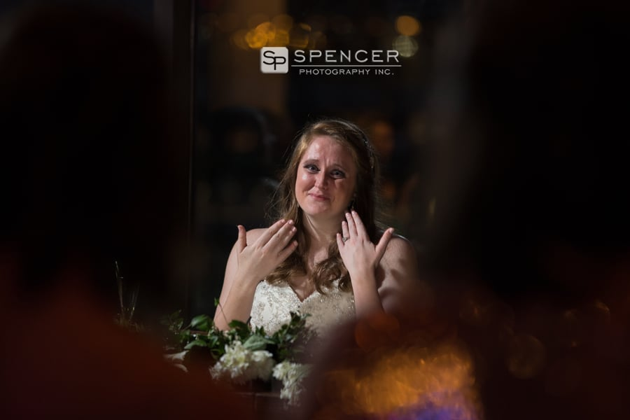 bride holding back tears at her wedding reception