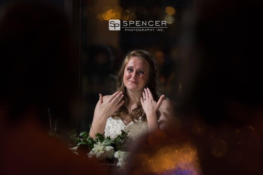 bride holding back tears at her wedding reception