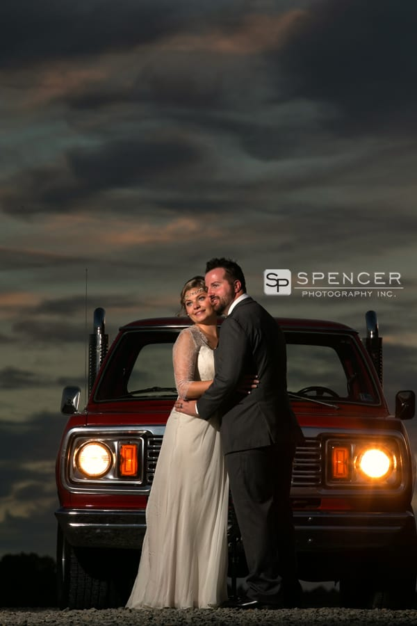 wedding picture by classic car at breitenbach