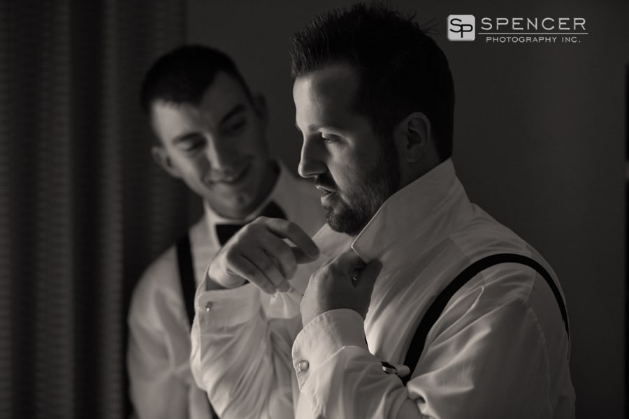 groom adjusting collar