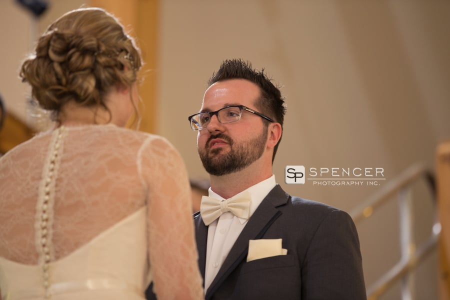 groom looking at bride at wedding at breitenbach