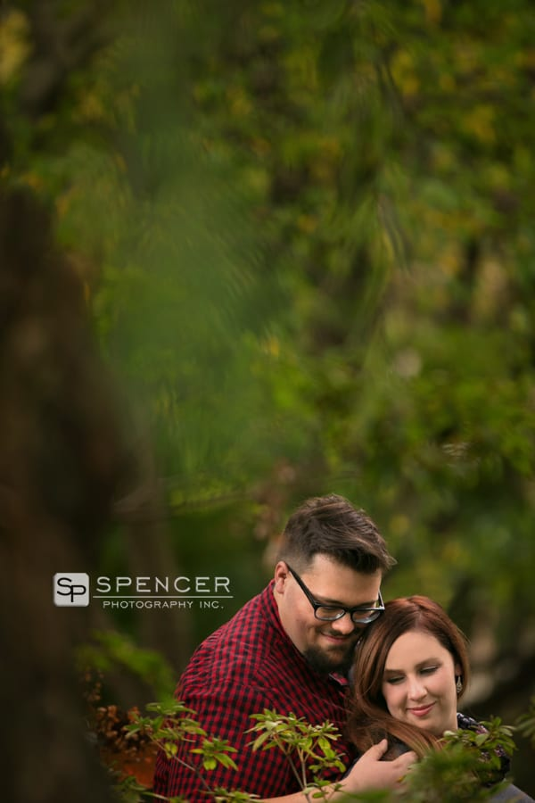 engagement picture in trees at wade oval