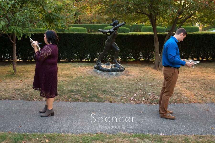 couple preparing for their birth announcement in wade oval.