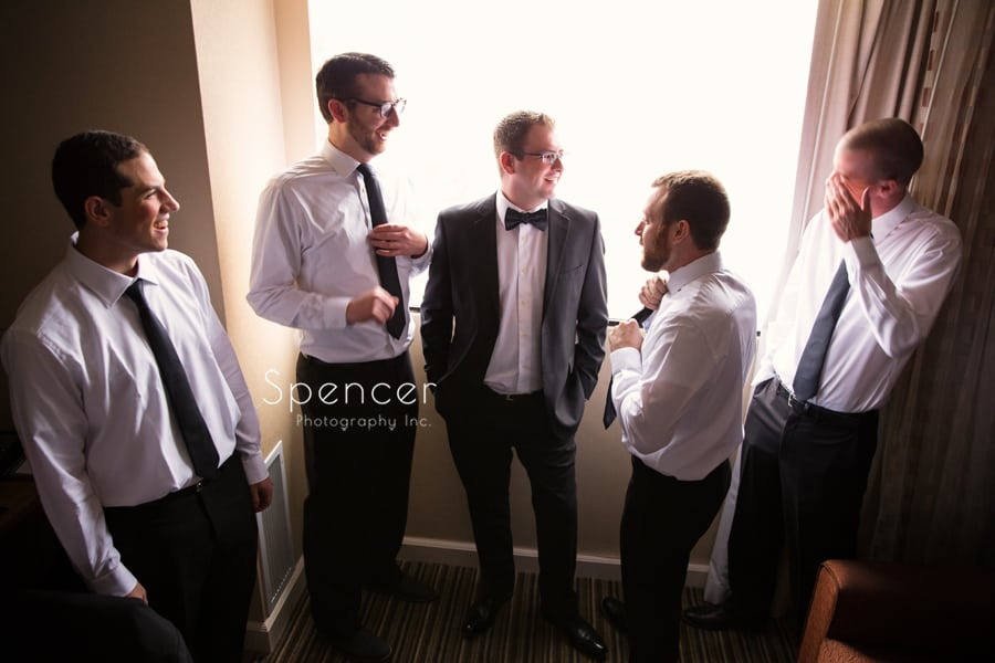 groomsmen talking with groom