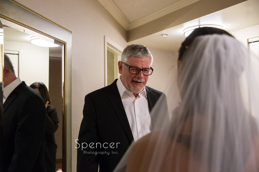 brides dad seeing her in her wedding dress