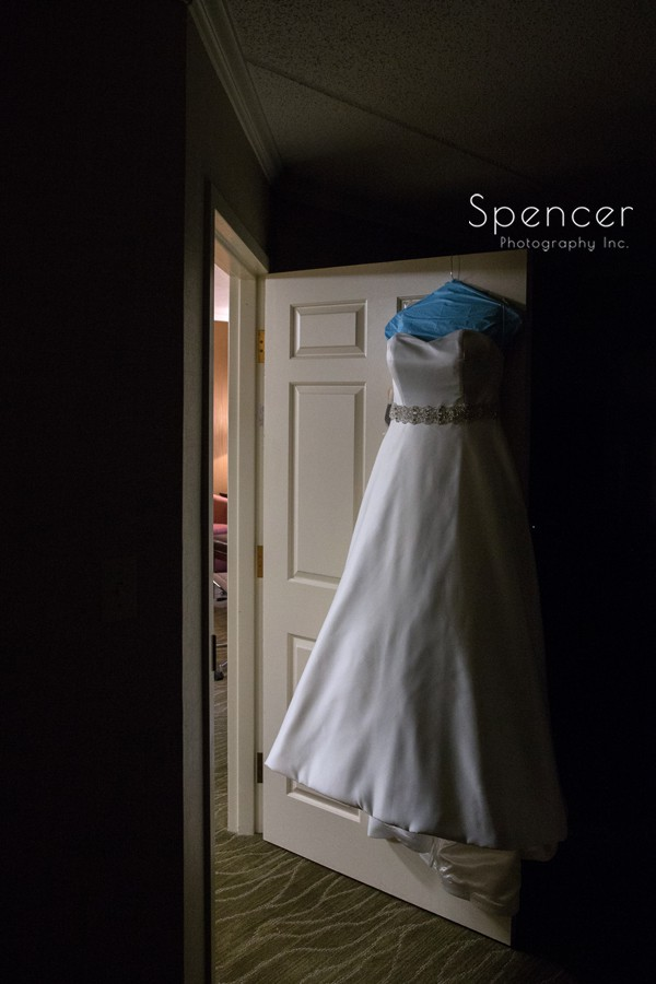 wedding dress haning on door