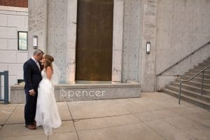 bride kissing at akron courtyard marriott