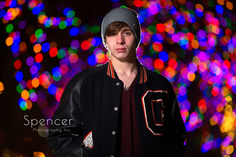 cleveland senior in front of christmas lights