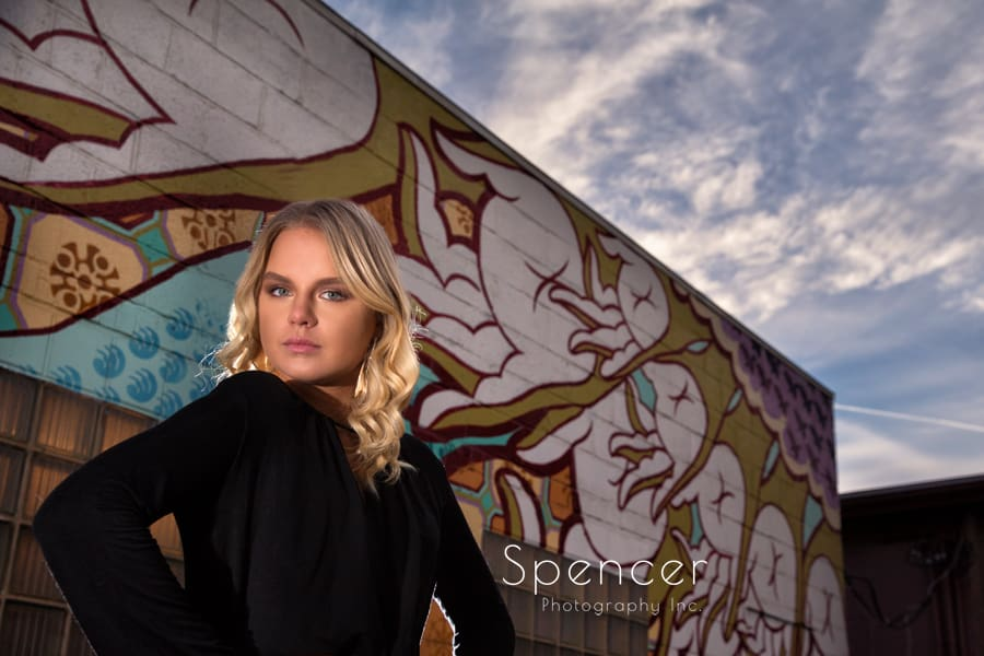 senior picture in front of painted wall in akron