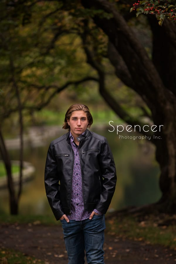 senior picture in wade oval park by trees