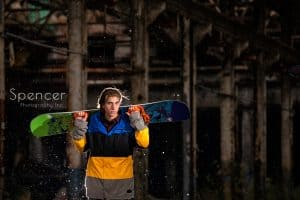 senior picture with snowboard