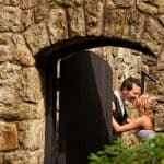 bride and groom kissing at stan hywet english garden