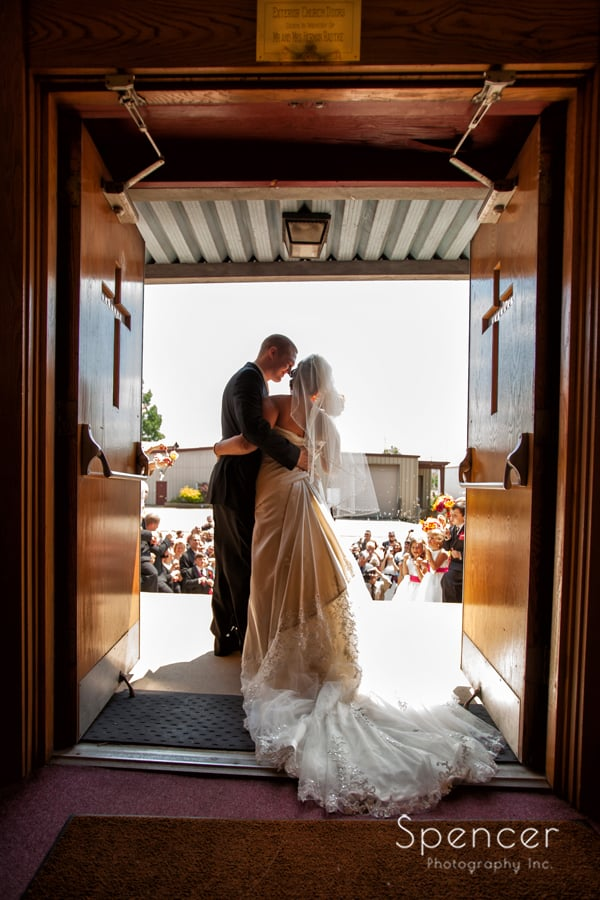 bride and groom exit their wedding in Canton Ohio