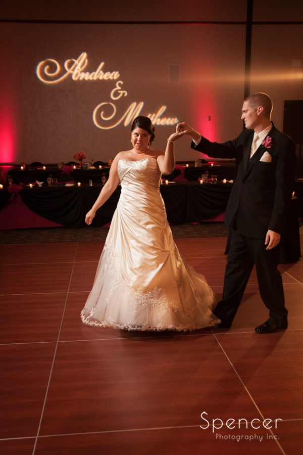 bride and groom enter reception at kent conference center