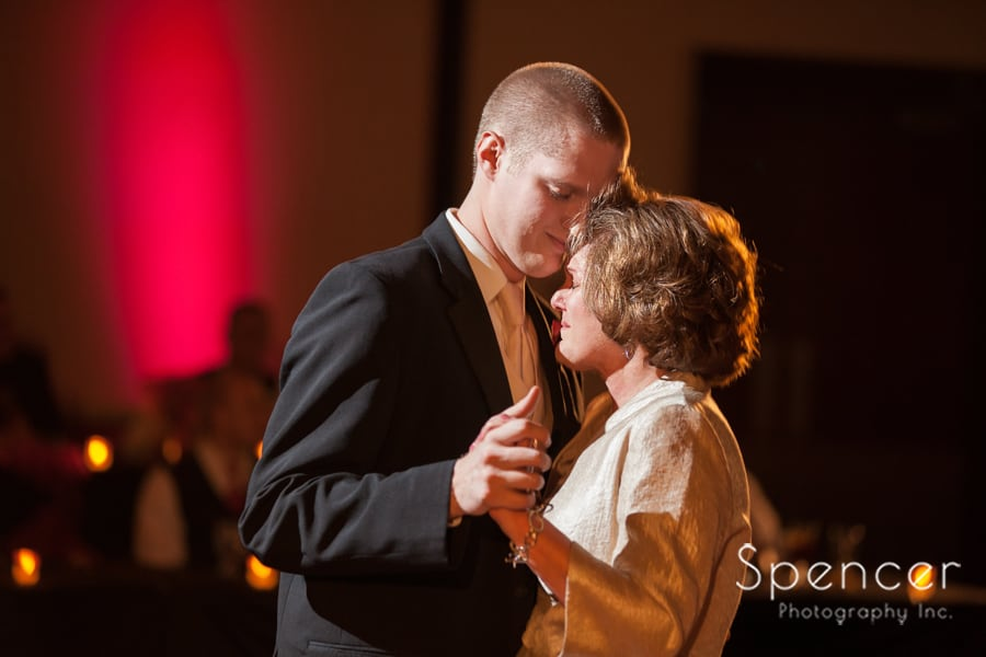 groom dancing with mom at wedding receptionat kent conference center
