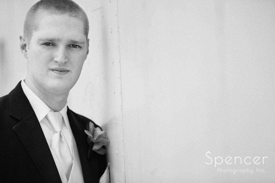 black and white wedding day portrait of groom