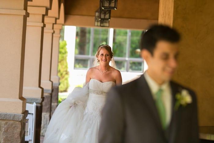 bride approaching groom for their first look at Gervasi vineyard