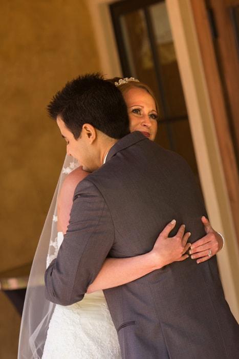 bride and groom hugging outside villa at Gervasi