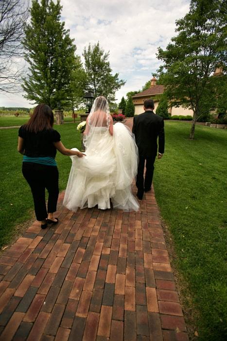 bride walking to her wedding ceremony at Gervasi