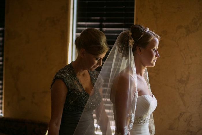 bride putting on her wedding dress at Gervasi
