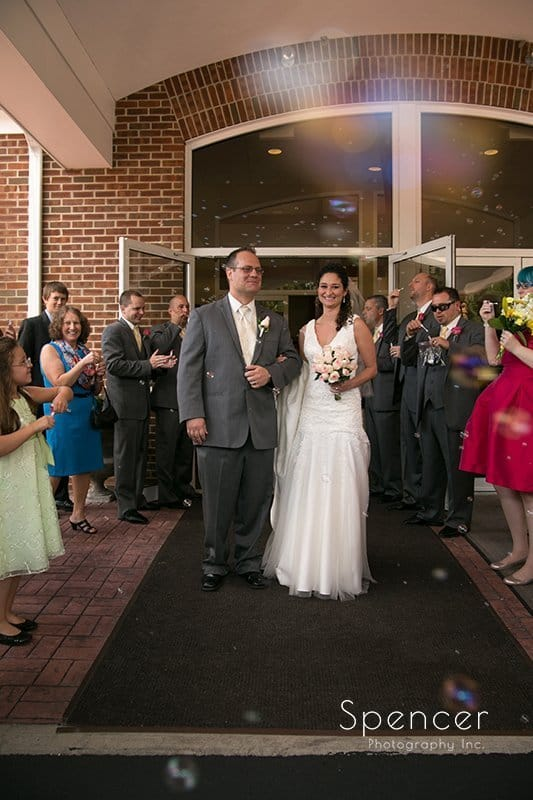 bride and groom exiting their wedding in Tallmadge Ohio