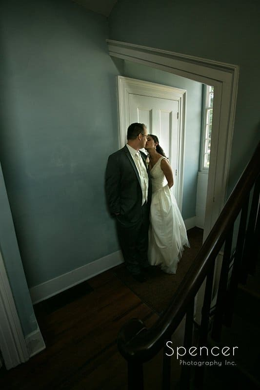 bride and groom standing in doorway of First Congregational Church of Tallmadge