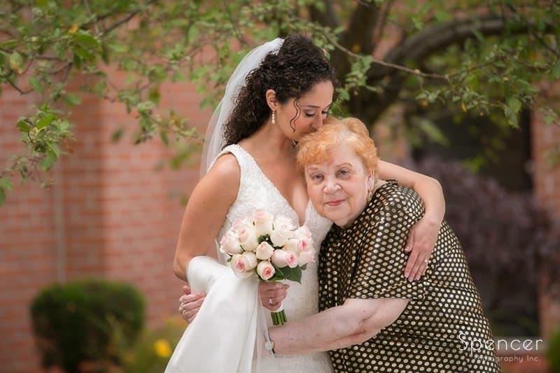 bride hugging grandma at church in Tallmadge Ohio