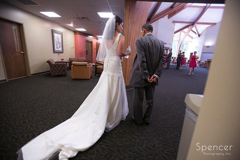 bride waiting to walk down aisle at wedding in Tallmadge