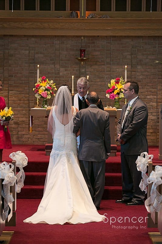 bride and groom on altar during wedding in Tallmadge Ohio
