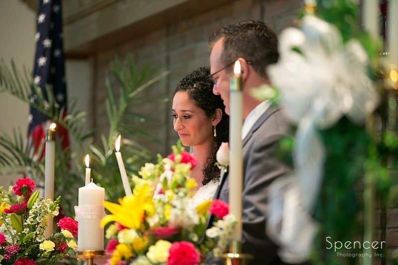 bride and groom lighting candle at wedding in Tallmadge Ohio