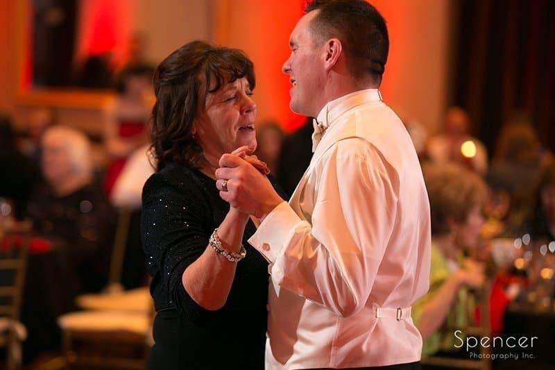 groom dancing with mom at Chrismas reception at Bertam Inn Aurora