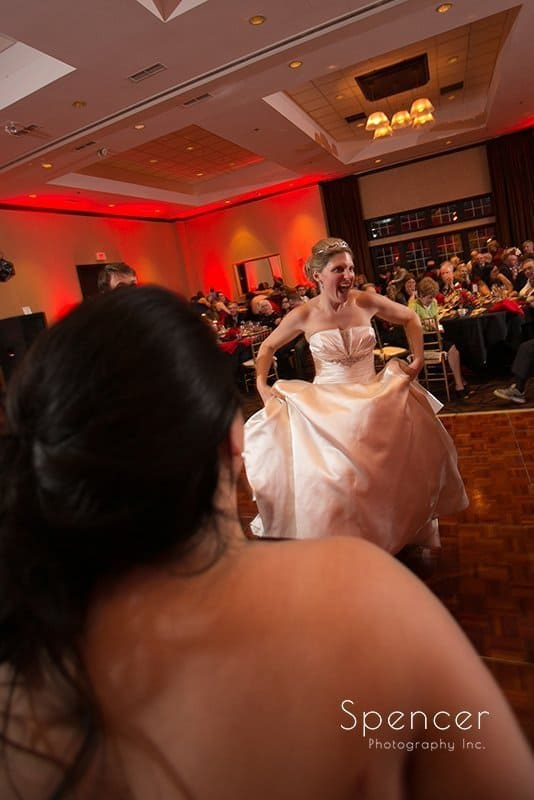 bride dancing at her Christmas wedding reception at The Bertram in Aurora