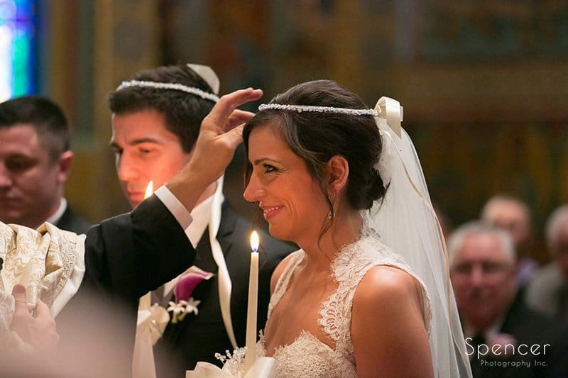 bride being crowned at her Greek wedding in Akron, Ohio