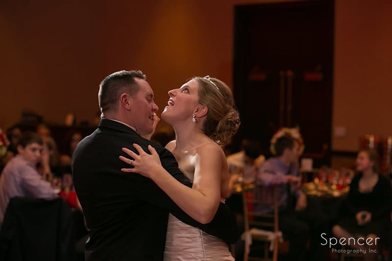 bride singing during first dance during Christmas wedding reception at the Bertram
