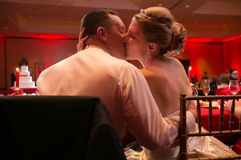 bride and groom kissing at Christmas wedding reception at The Bertram Inn
