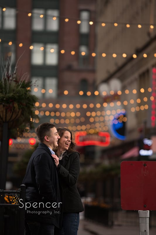 couple laughing during engagement pictures on east fourth street cleveland