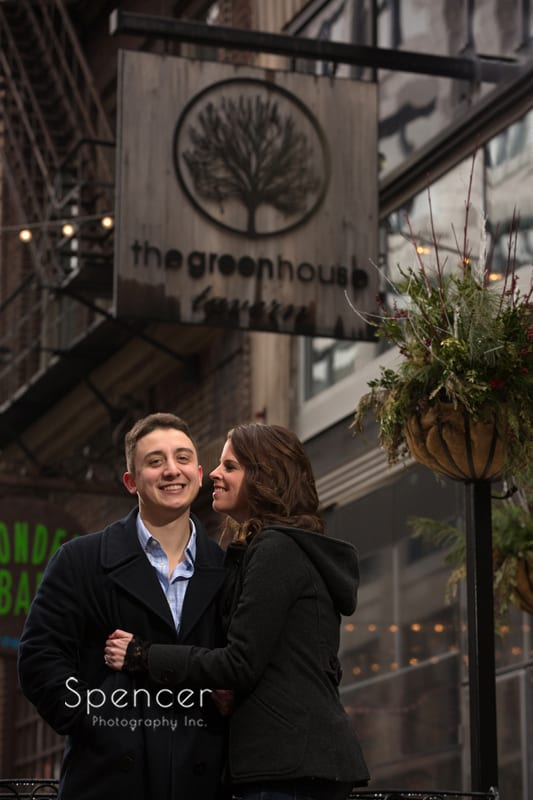couple posing for engagement pictures at greenhouse tavern cleveland