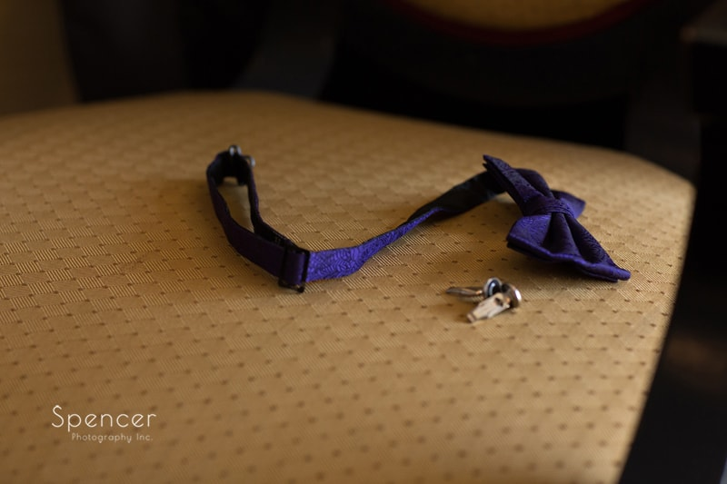 detail of groom wedding items